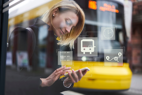 Image of a young woman with blond hair using on demand transport smartphone app
